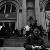 Black and white photo of Xinyu Liang on the steps of The Met